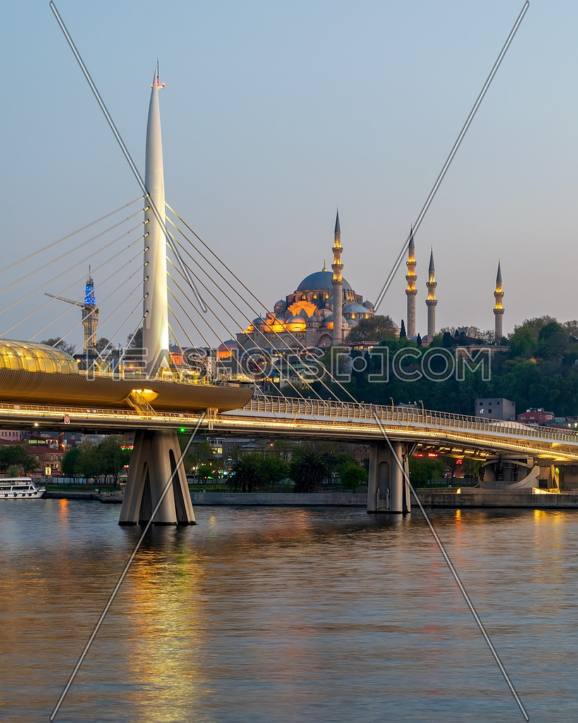 Night shot of Golden Horn Metro Bridge (Halic Bridge) overlapping Suleymaniye Mosque, Istanbul, Turkey