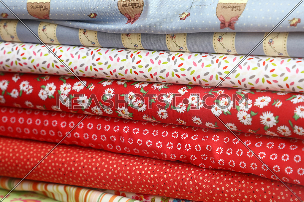 Close up swatch of assorted colorful textile fabric for decoration and sewing tailor craft