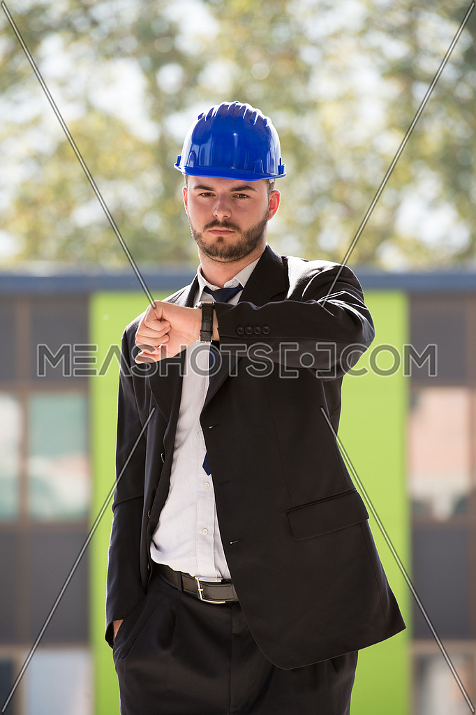 Businessman Looking At The Time On His Wrist Watch