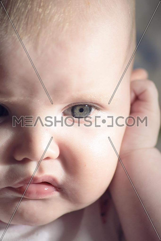 a baby giving a grumpy reaction