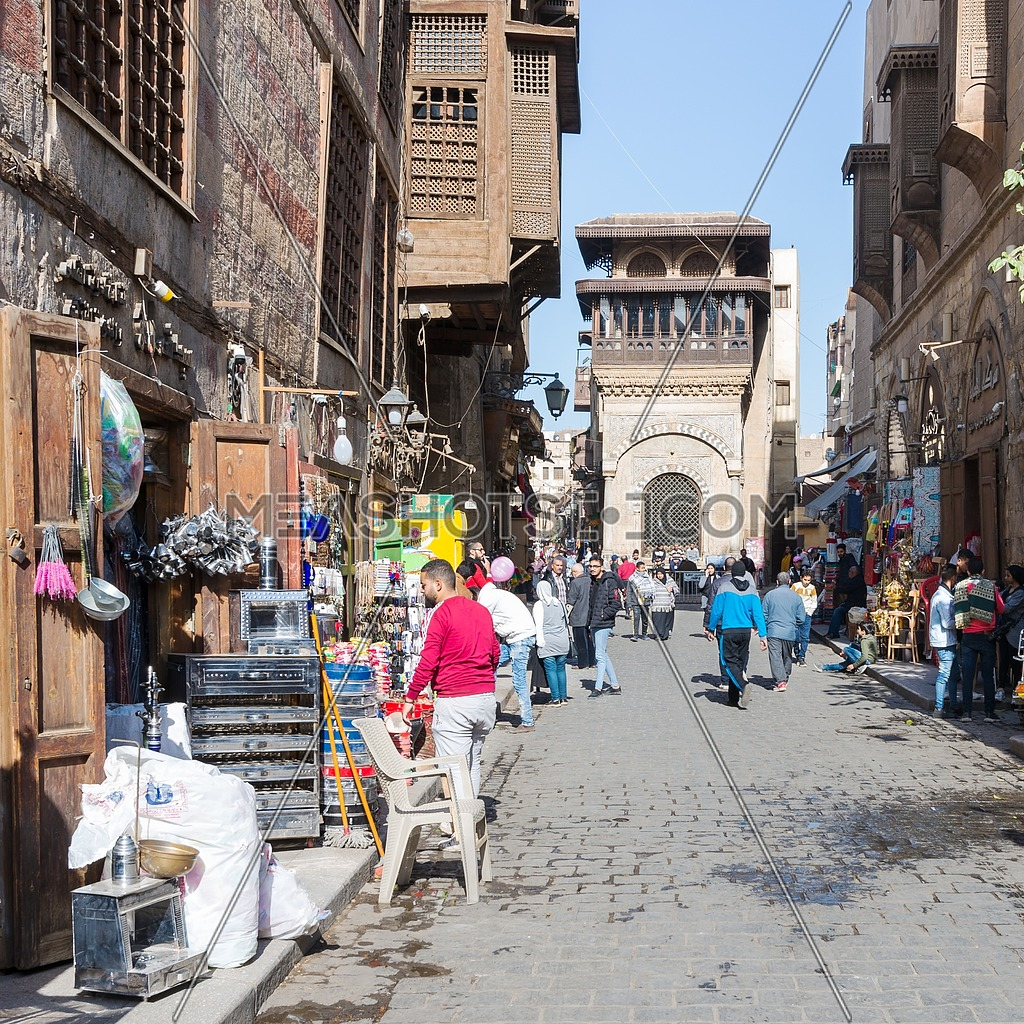 Cairo, Egypt- December 14 2019: Moez Street with local visitors and Sabil-Kuttab of Katkhuda historic building at the far end, Gamalia district, Old Cairo