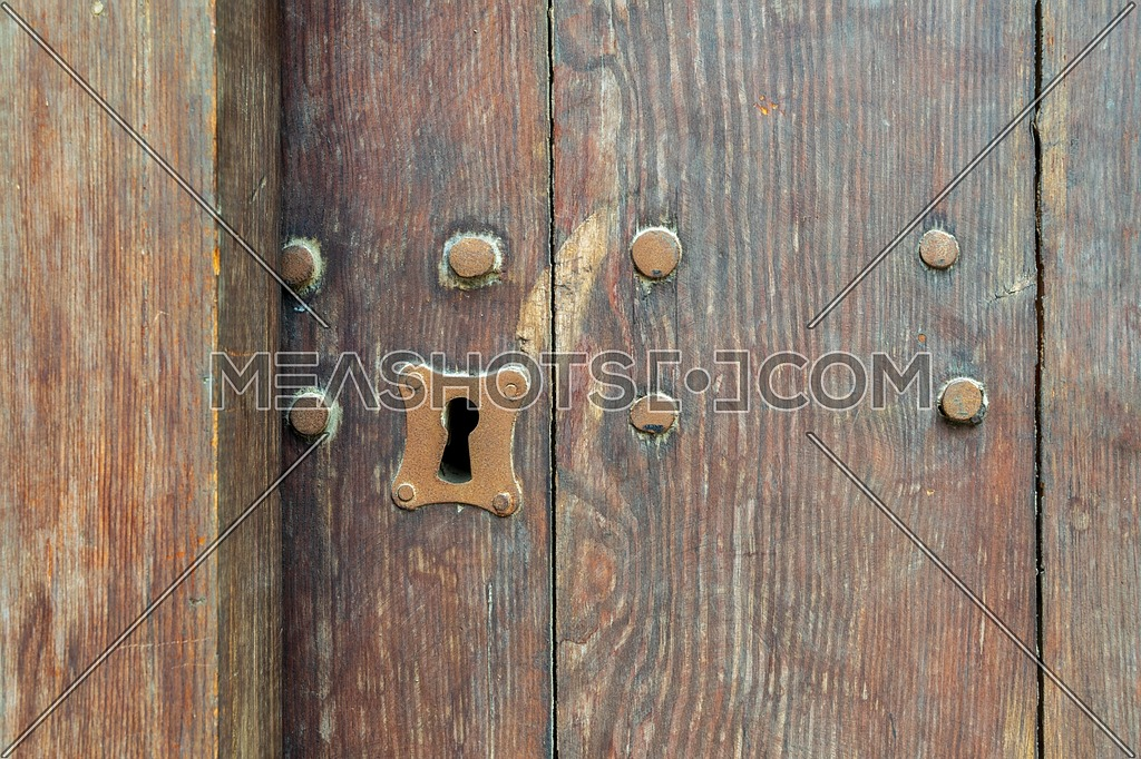Vintage keyhole in old wooden grunge door