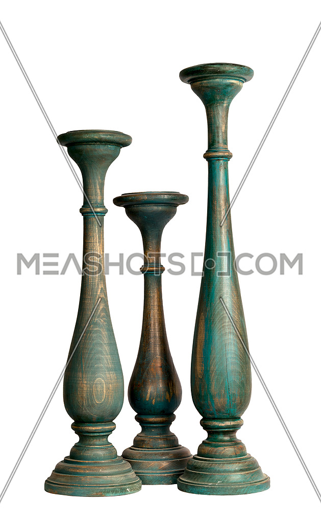 Composition of three blue-gray vintage wooden candlesticks