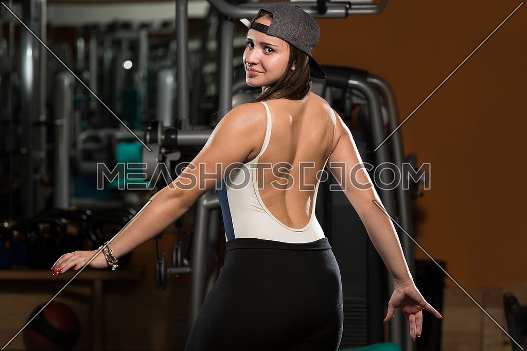 Portrait Of A Physically Fit Young Woman - Flexing Muscles
