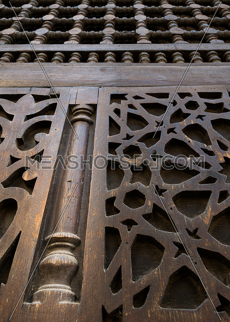 An interleaved wooden ornaments (Arabisk) unit, part of a facade in a historic house in Old Cairo, Egypt