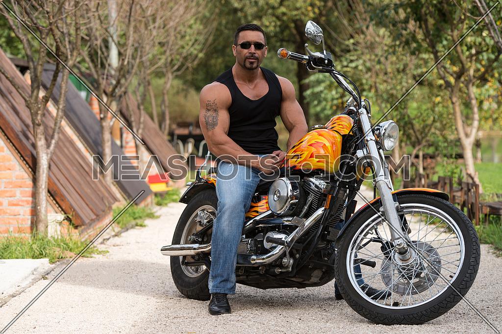 Biker Man Bodybuilder Sits On A Bike