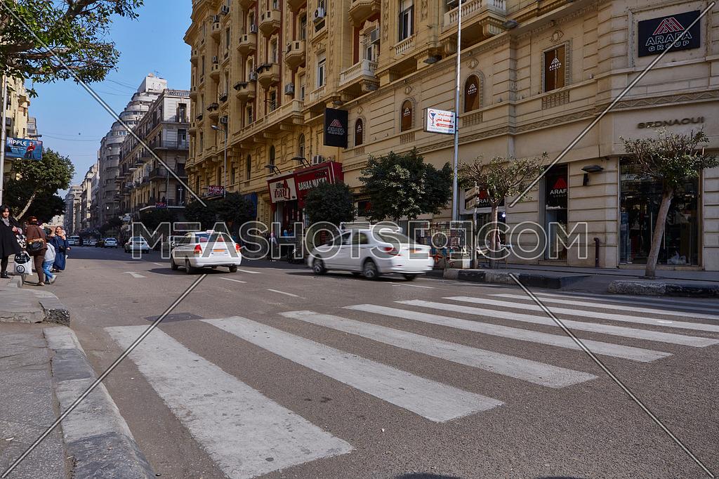 Long shot for pedestrain crossing Sherif Basha Street at cairo at Day