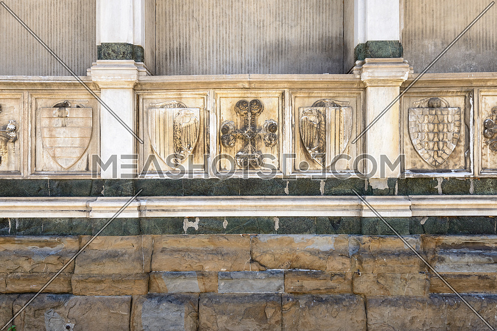 In the picture a close up the wall of Santa Maria Novelle in Florence , where we see symbols of Christianity and the medieval noble families .