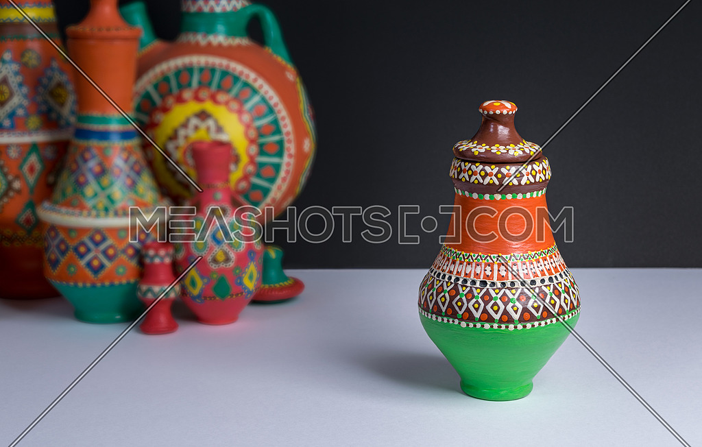 Photo For Still Life Of One Ornate Colorful Pottery Vase On