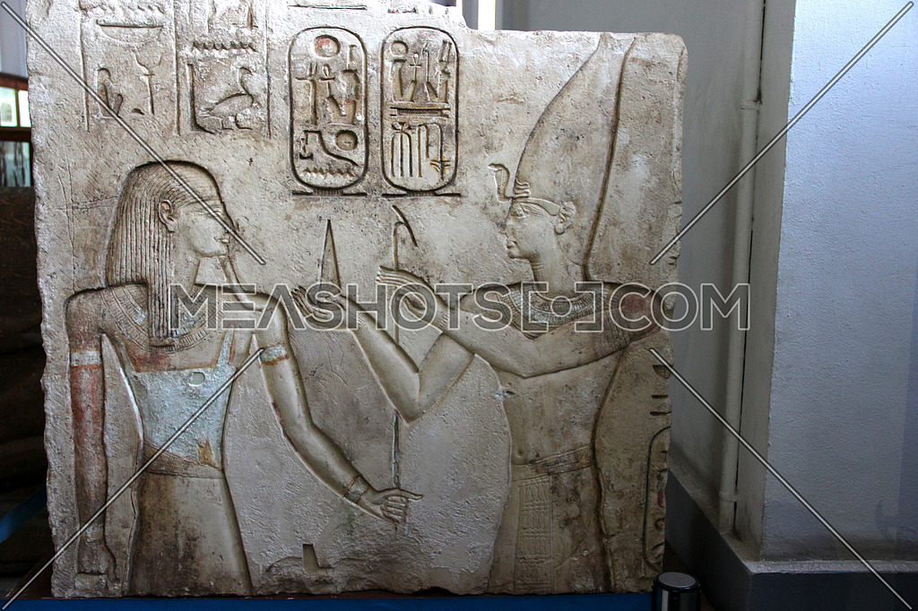 a photo from inside the Egyptian museum showing a display of monumental statues belongs to ancient Egyptian history and pharaohs civilization