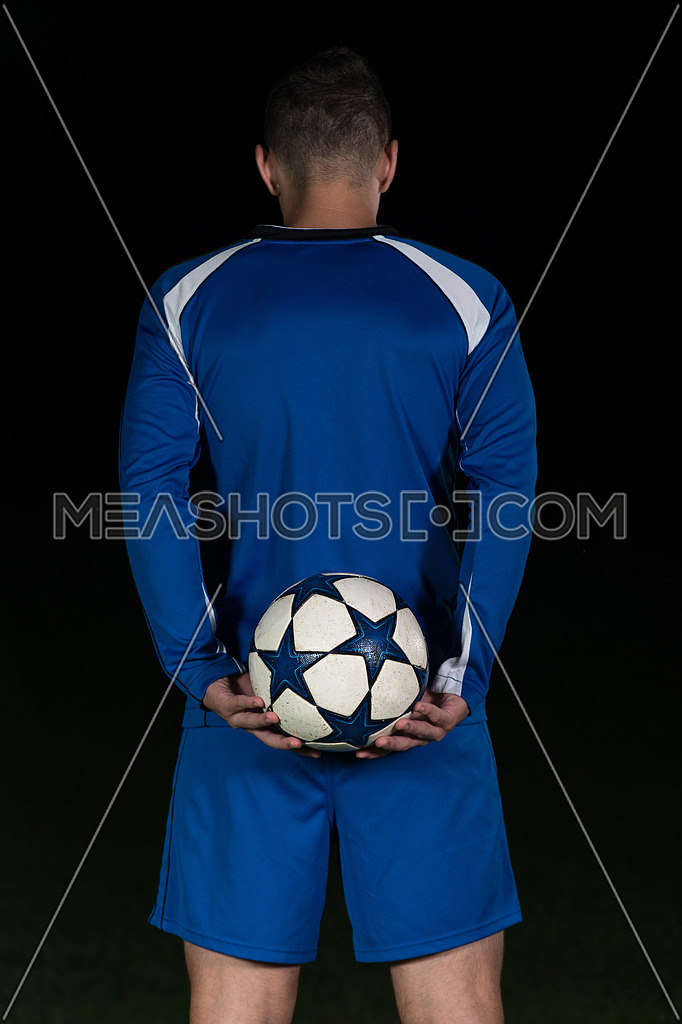 Back View Of Soccer Player In Blue Uniform Isolated On Black Background