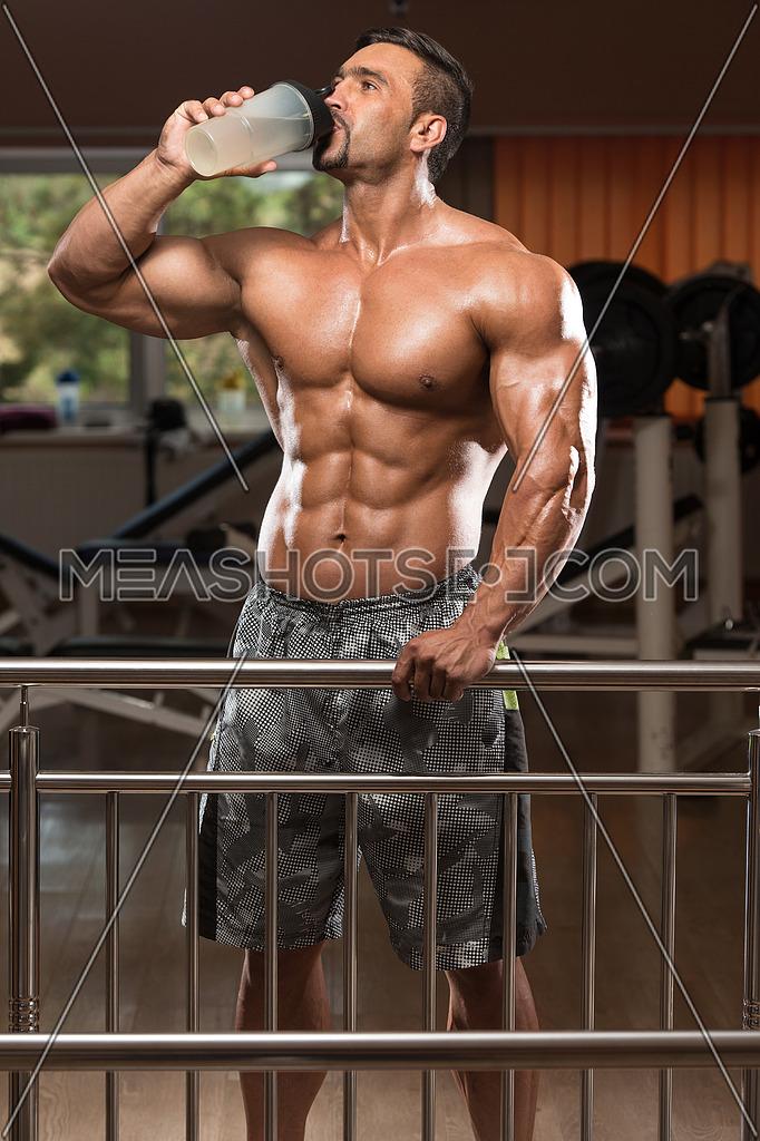 Muscular Man Drinking A Water Bottle