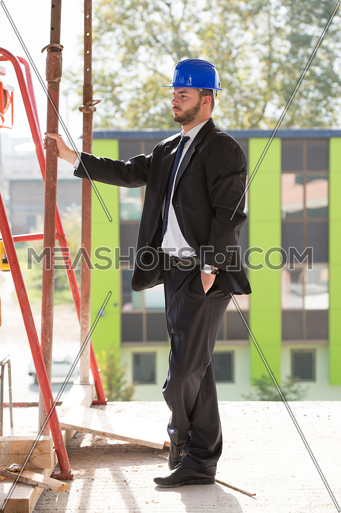 Portrait Of Business Man With Blue Helmet On Construction