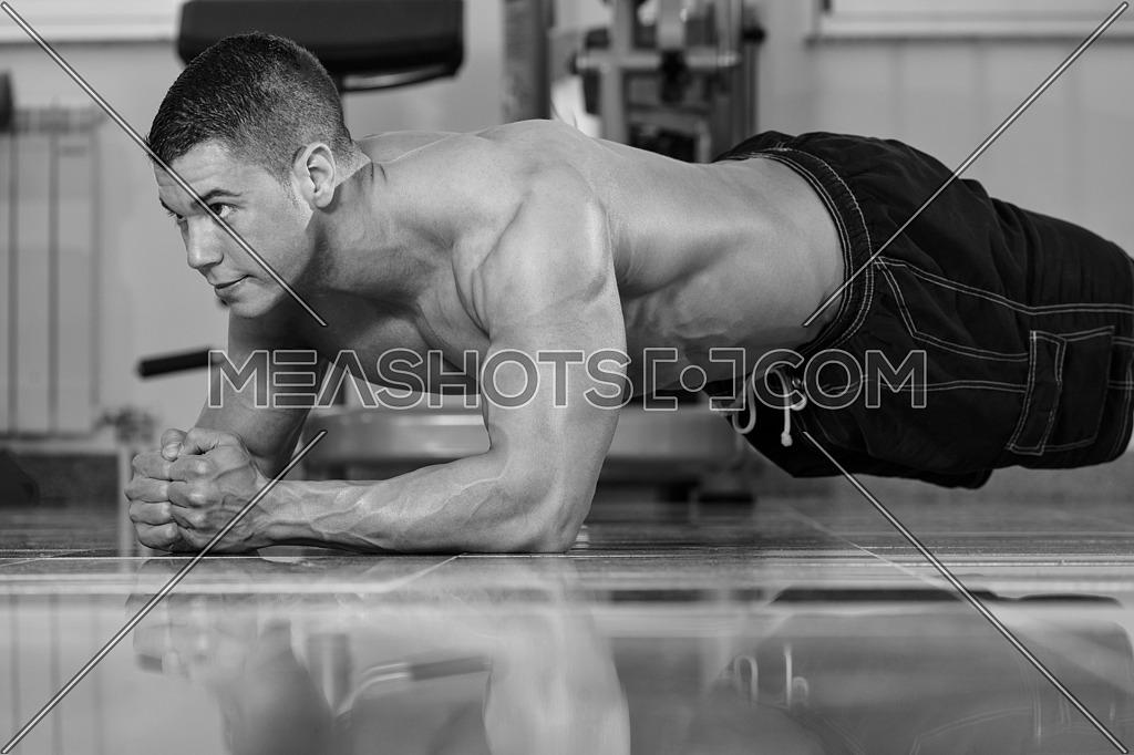 Healthy Young Man Exercising Abdominals On Foor