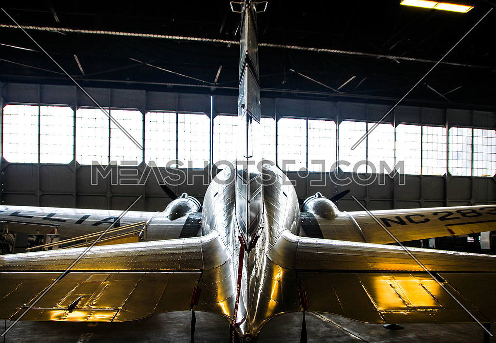 a douglas dc3 in hanger from behind