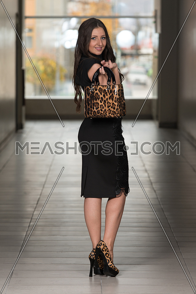 Portrait Of Young And Beautiful Fashion Model In The Shopping Mall - Professional Makeup And Hair Style