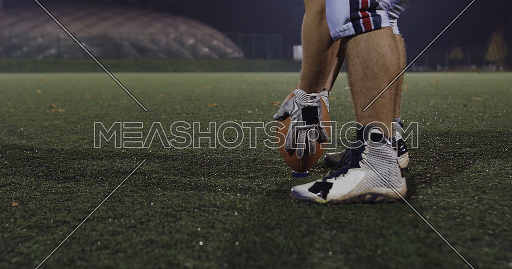 american football kicker ready for football kickoff closeup shot on the night field
