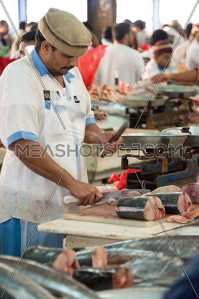 sales man cutting fish in Fish Market In-41715 | Meashots
