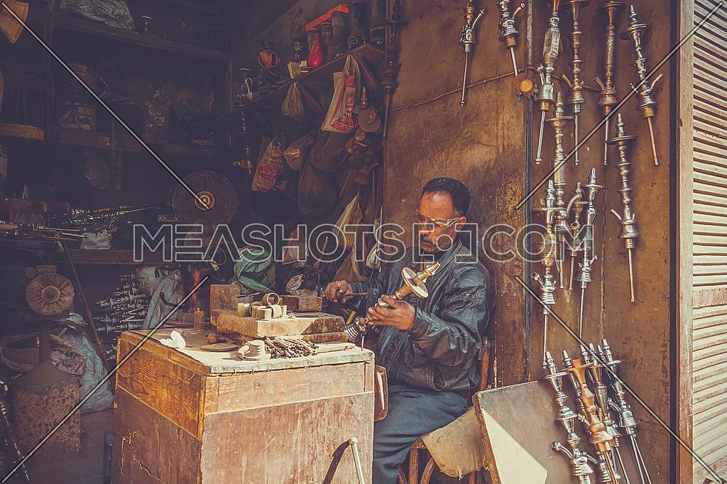 A Crafts man creating Shisha parts
