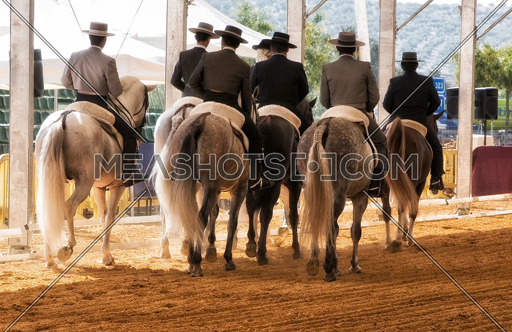 Group of horsemen riding on their backs after dressage exhibition denim in Andujar, Jaen province, Andalucia, Spain