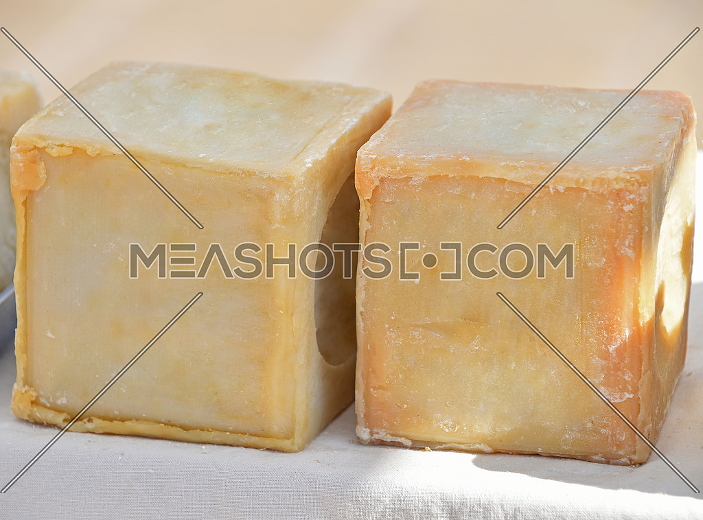 Traditional dish or laundry yellow household Marseilles hard soap block at retail display