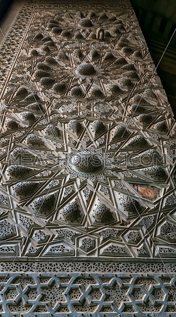 Geometrical engraved bronze-plate decorations of the main entrance of public ancient mosque of Sultan Al Moaayad, Old Cairo, Egypt