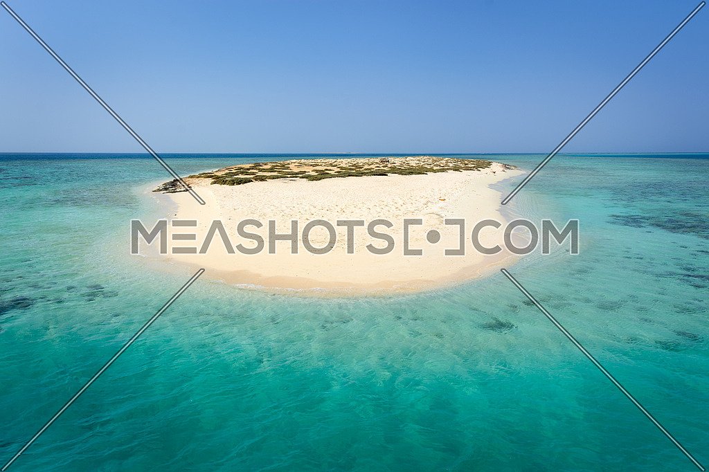 In the picture an atoll with fine white sand, turquoise sea and surrounded by green situated in the Red Sea in Egypt, situated between the area of Hamata and Berenice.