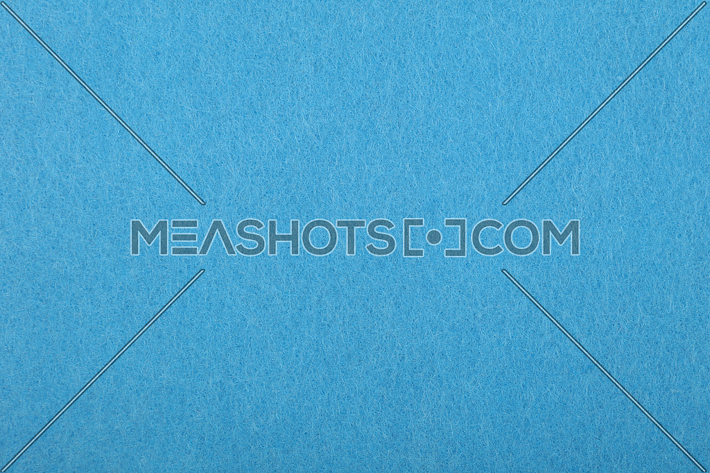 Light blue colorful felt soft rough textile material background texture close up