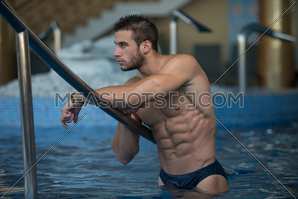 Fashion Portrait Of A Very Muscular Sexy Man In Underwear At Swimming Pool