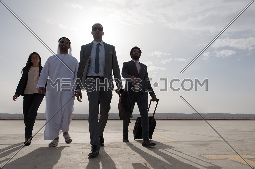 young successful middle eastern businessmen walking the runway with Arab business partner