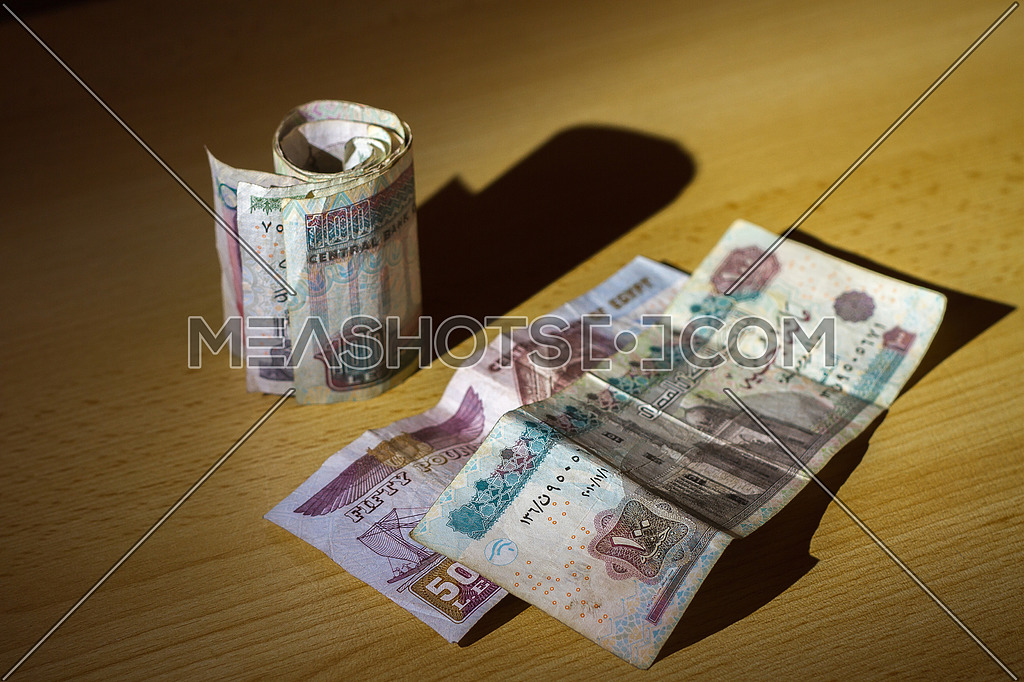 Egyptian Money on a wooden table top