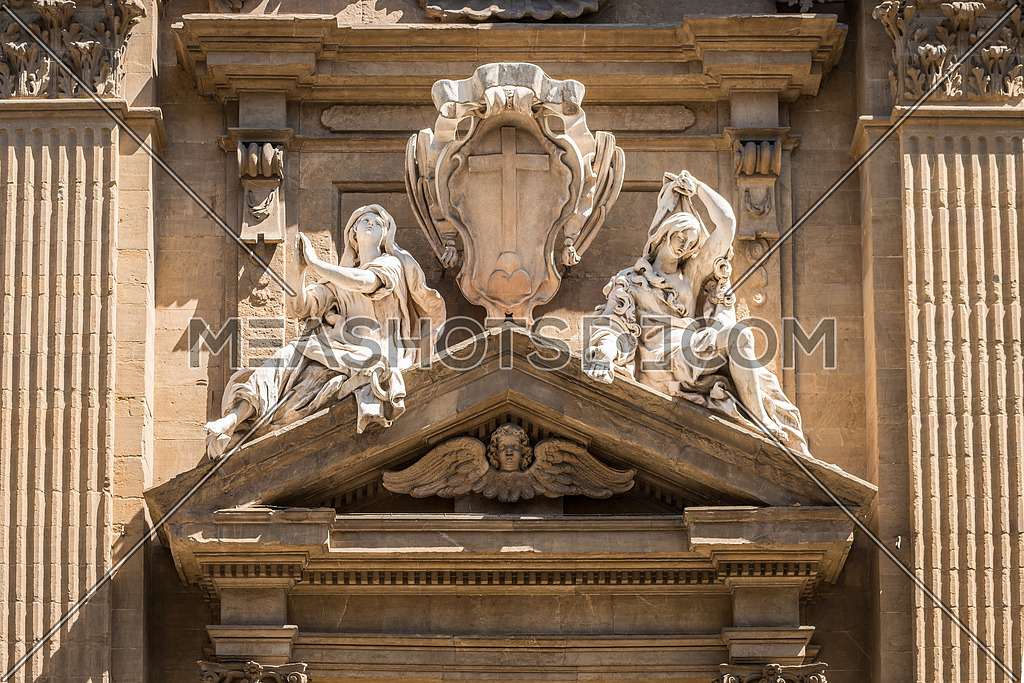 In the picture a marble statue of the Middle Ages showing two women, in the historic center of Florence.