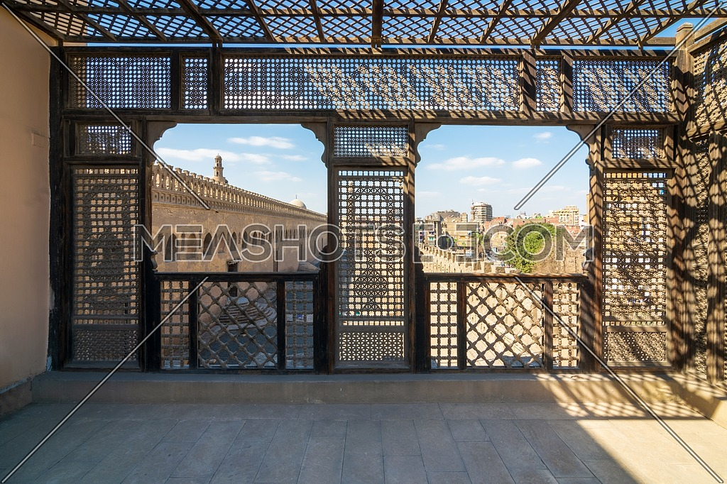 Passage surrounding the Mosque of Ibn Tulun framed by interleaved wooden perforated wall, Mashrabiya, Medieval Cairo, Egypt