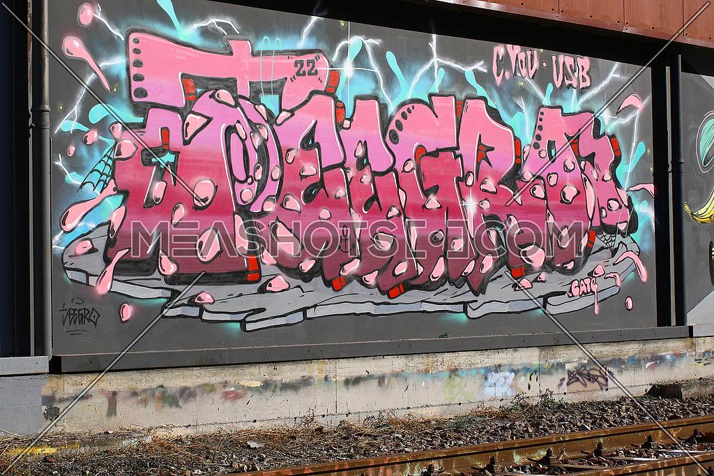 Cadenazzo, Switzerland, February 2016, Urban wall texture along railroad tracks keep popping up along railway tracks, graffiti art abstract background