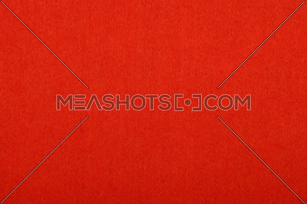 Scarlet red colorful felt soft rough textile material background texture close up