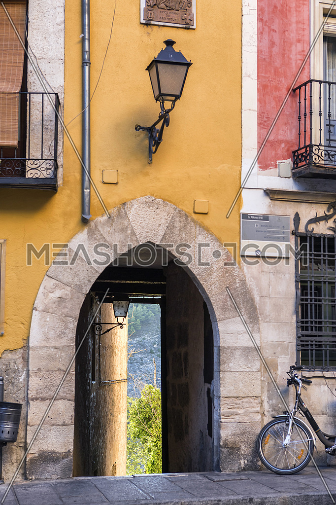 Arch of entry to a street close to the cathedral of Cuenca to the evening, Cuenca, Spain