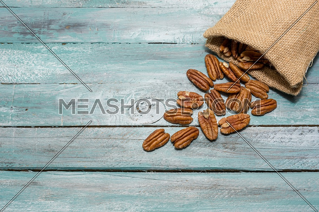 Tasty pecan on the old background. Healthy edible seeds food ingredient on the table.