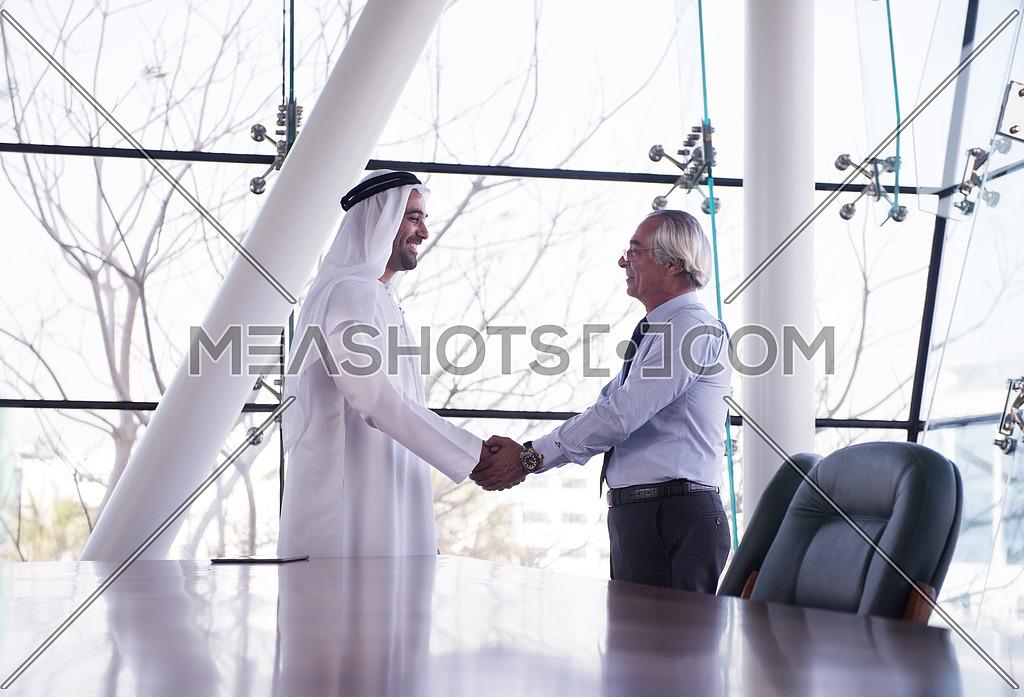 arabian businessman handshake-61866   Meashots