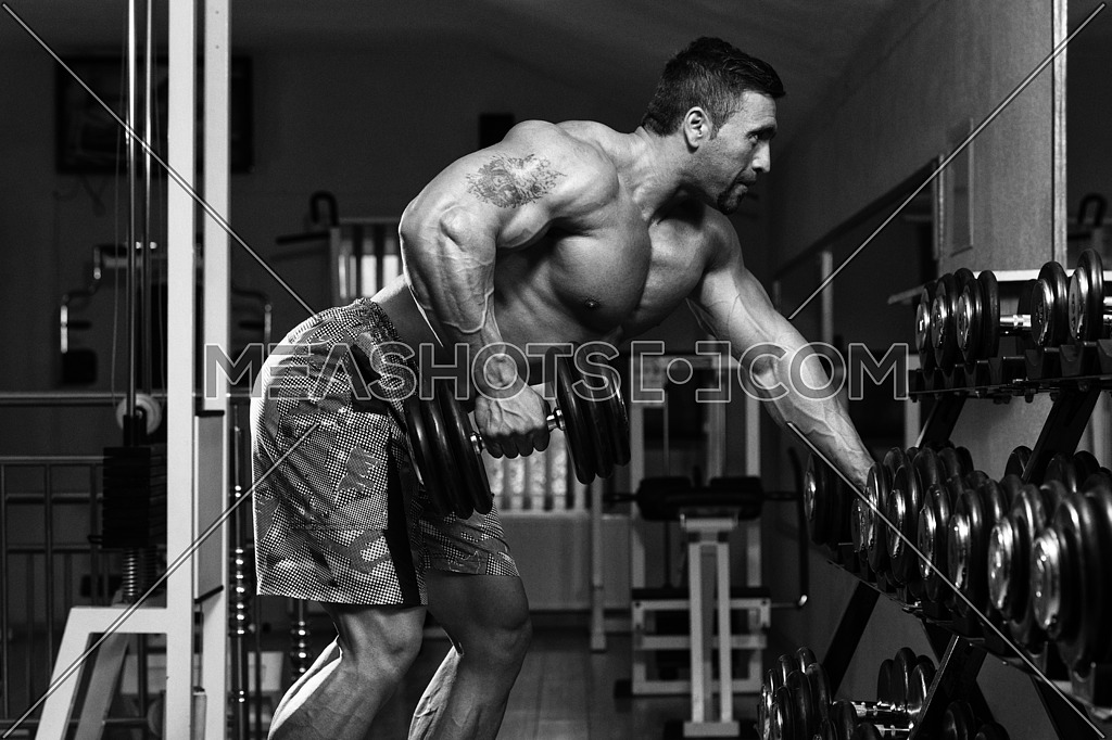 Mexican Bodybuilder Doing Heavy Weight Exercise For Back With Dumbbells