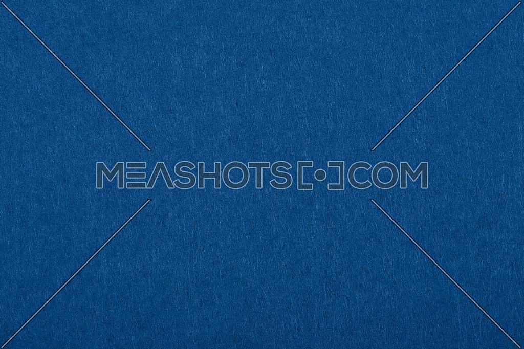 Dark classic blue felt soft rough textile material background texture close up