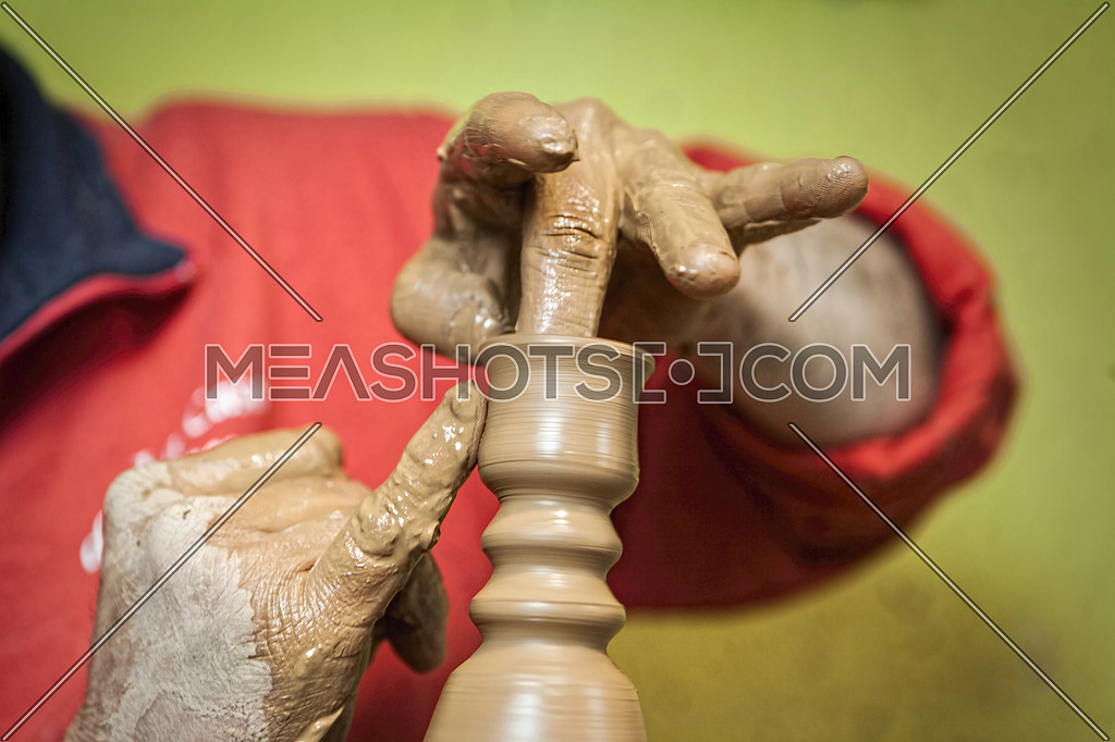 Potter making a humble candle holder of ceramics with their hands, ceramics typical of Bailén, Jaen province, Andalucia, Spain