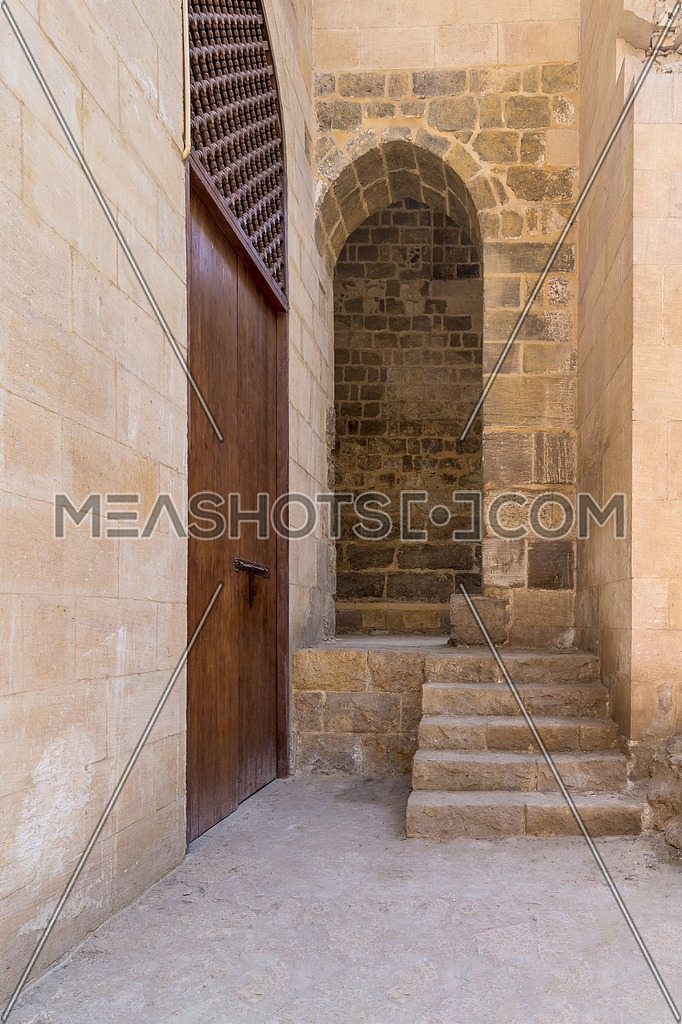 Stone staircase leading to vaulted entrance at stone bricks wall, Medieval Cairo, Egypt