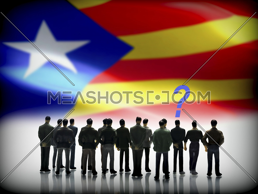 Several men looking at the flag of Catalonia, conceptual image