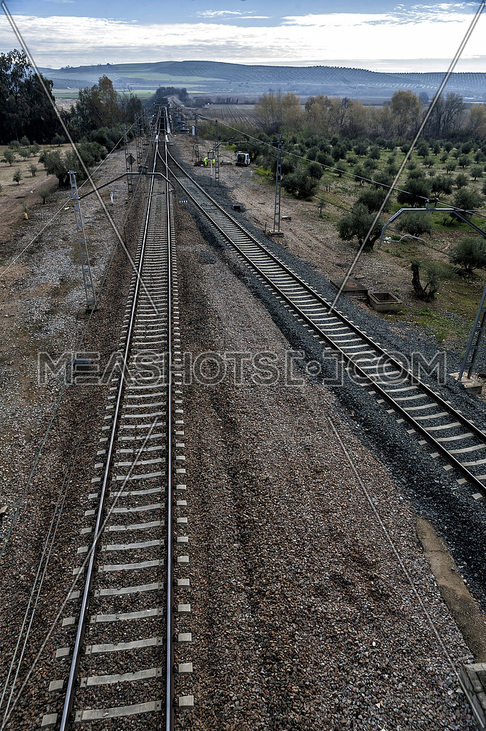 Train rails with a city at the background, Jaén, Spain