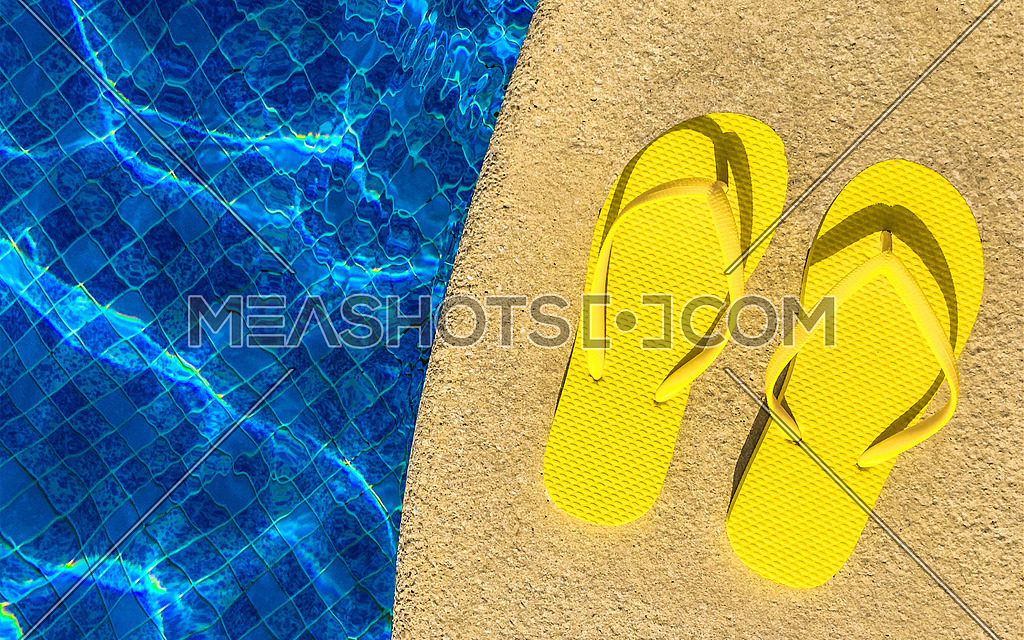 yellow slippers by the pool