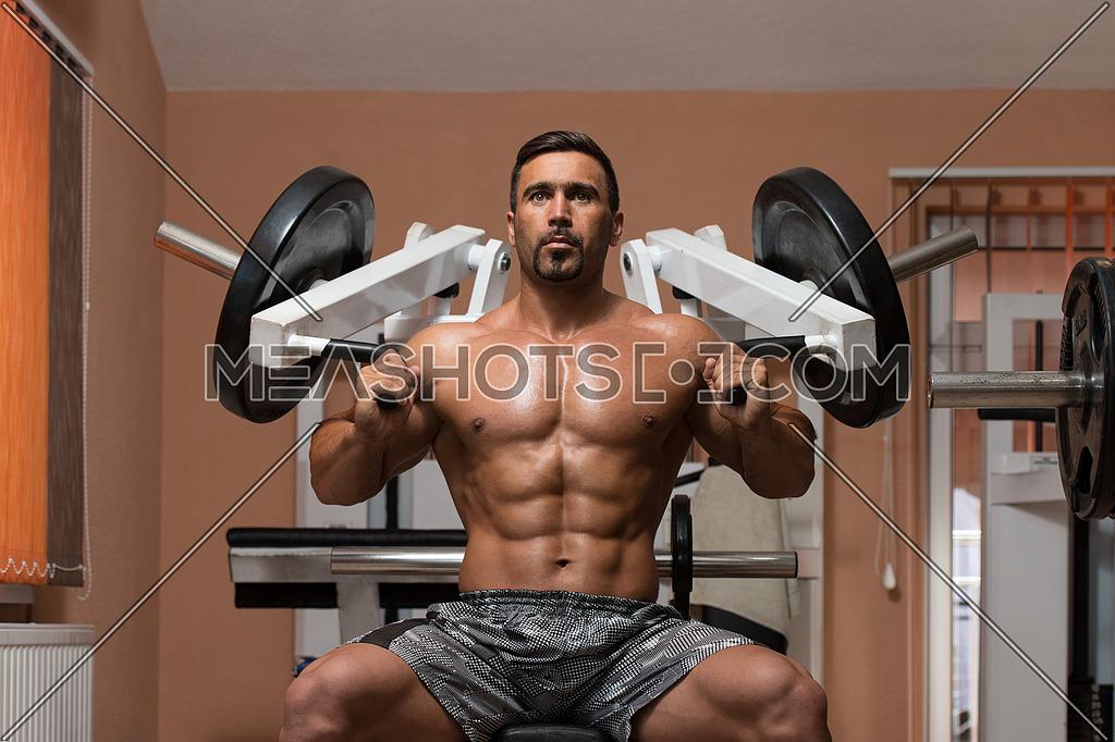 Latin Bodybuilder Working Out Shoulders - Dumbbell Concentration Curls
