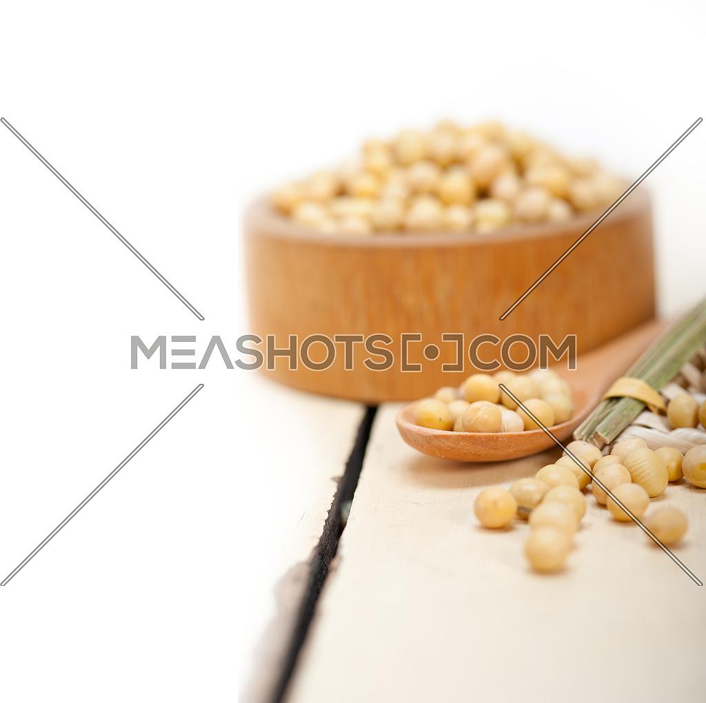 organic soya beans over rustic wood table macro closeup