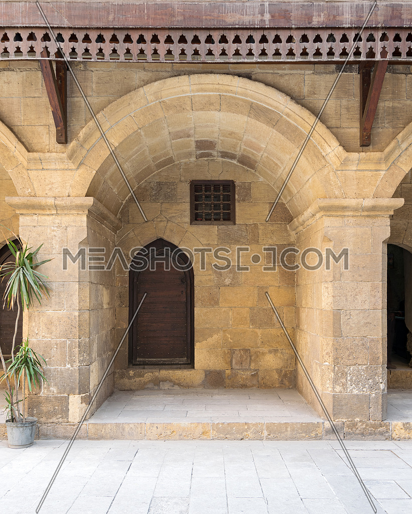 Wooden door and window covered with interleaved wooden grid at caravansary (Wikala) of Bazaraa, suited in Tombakshia street, Al Gamalia, Cairo, Egypt