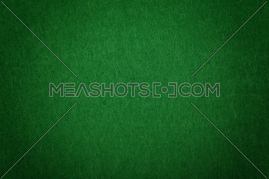 Dark green poker table felt soft rough textile material background texture close up with shade vignette