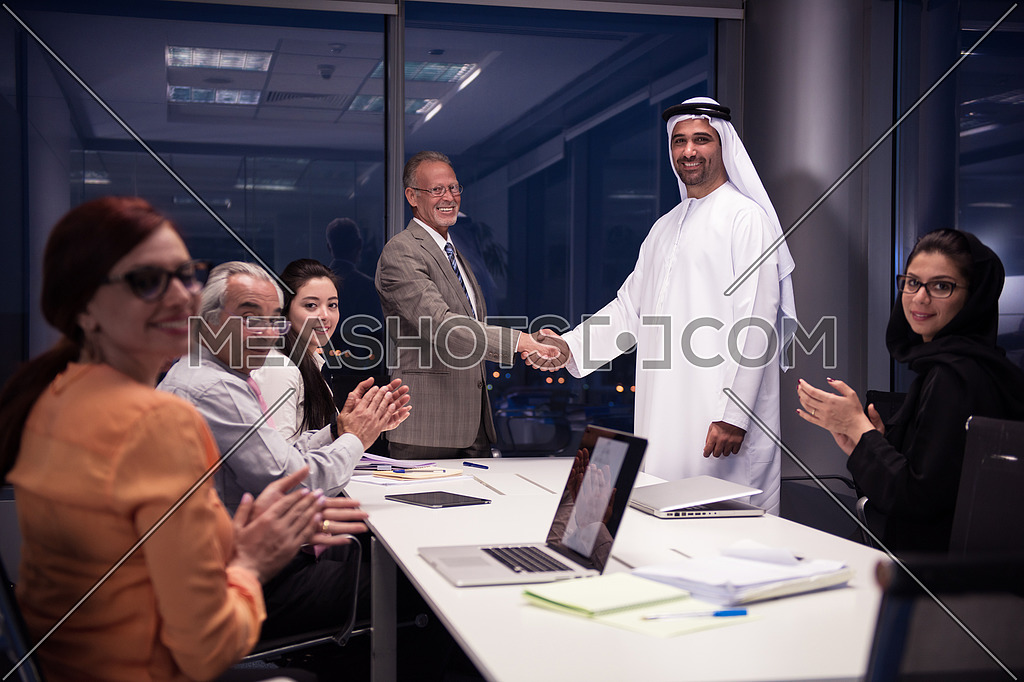 business people make agreement and handshake on meeting at modern office ate late night